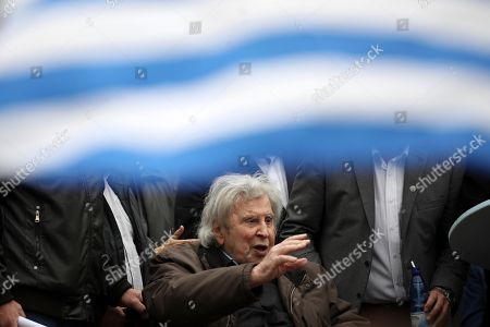 Famous Greek composer Mikis Theodorakis waves to the crowd after his speech at a rally in Athens, . Protesters from across Greece converged Sunday on Athens' main square outside parliament to protest a potential Greek compromise in a dispute with neighboring Macedonia over the former Yugoslav republic's official name