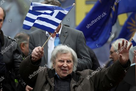 Stock Picture of Famous Greek composer Mikis Theodorakis waves to the crowd after his speech at a rally in Athens, . Protesters from across Greece converged Sunday on Athens' main square outside parliament to protest a potential Greek compromise in a dispute with neighboring Macedonia over the former Yugoslav republic's official name