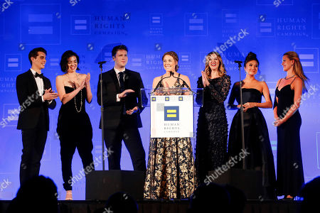 Kyle Selig, Barrett Wilbert Weed, Grey Henson, Erika Henningsen, Taylor Louderman, Ashley Park, Kate Rockwell. Cast members of the Broadway show Mean Girls, from left, Kyle Selig, Barrett Wilbert Weed, Grey Henson, Erika Henningsen, Taylor Louderman, Ashley Park and Kate Rockwell speak at the 2018 Human Rights Campaign Greater New York Gala on in New York