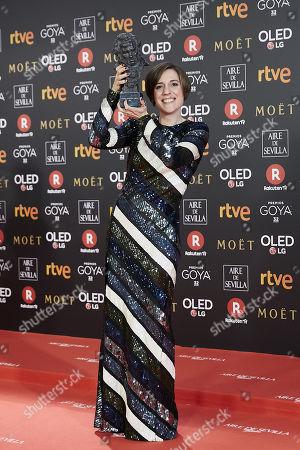 Carla Simon holds the best new director award for the film  'Summer 1993'