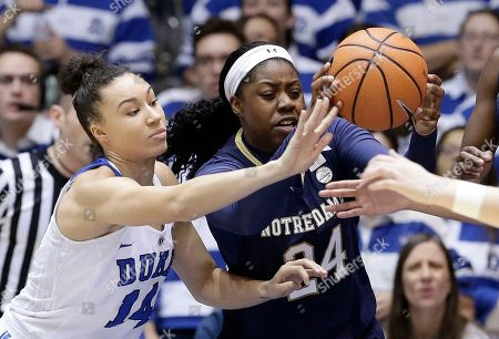 Stock Picture of Faith Suggs, Arike Ogunbowale. Notre Dame's Arike Ogunbowale (24) and Duke's Faith Suggs (14) chase the ball during the first half of an NCAA college basketball game in Durham, N.C
