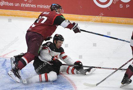 Gints Meija Wojtek Wolski. Latvia's Gints Meija, left, and Canada's Wojtek Wolski fight for the puck during an exhibition hockey game in Riga, Latvia