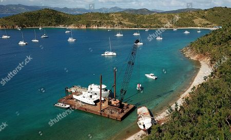 A salvage crew lifts the wreckage of the restaurant and bar Willie T's which was anchored in The Bight Bay off Norman Island in Norman Island, British Virgin Islands, . The boat was damaged by Hurricane Irma which wreaked havoc in parts of the region, including Antigua and Barbuda, Anguilla and St. Martin, the U.S. and British Virgin Islands, Turks and Caicos, the Bahamas and parts of Cuba