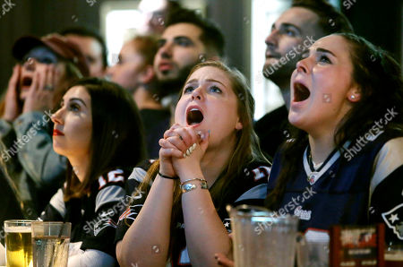 Stock Image of Kathleen Doherty, center, of Woburn, Mass., reacts with other fans at a Boston bar while watching the New England Patriots' final drive during the first half of the NFL Super Bowl 52 football game between the Patriots and the Philadelphia Eagles in Minneapolis