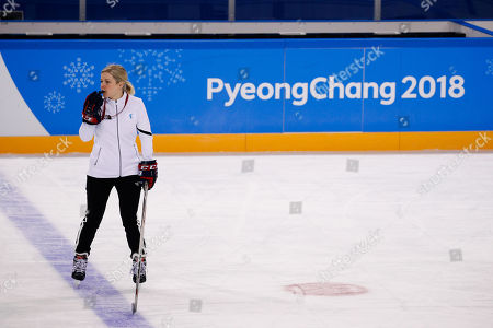 The joint Korean women's ice hockey team head coach Sarah Murray watches her players train prior to the 2018 Winter Olympics in Gangneung, South Korea
