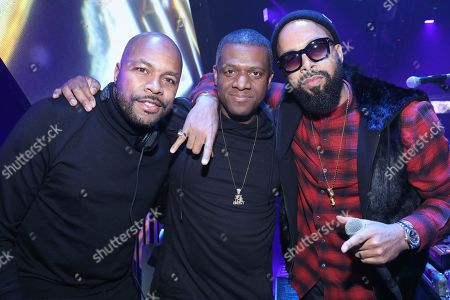 Stock Image of DJ Nasty, DJ D-Nice, Kenny Burns. DJ D-Nice, left, DJ Nasty, and Kenny Burns pose for a photo at The Player's Ball at The Armory, in Minneapolis