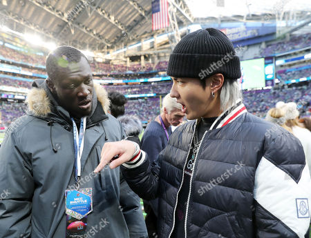 English grime and hip hop artist Stormzy, talks to Singer Kris Wu while attending Super Bowl LII 