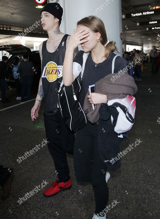 Editorial image of Lily-Rose Depp and Ash Stymest at LAX International Airport, Los Angeles, California, USA - 03 Feb 2018