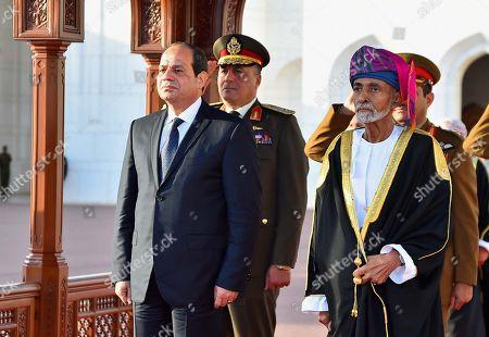 Stock Photo of Egyptian President Abdel Fattah al-Sisi and Oman's Sultan Qaboos bin Said al Said review the honor guards in Muscat