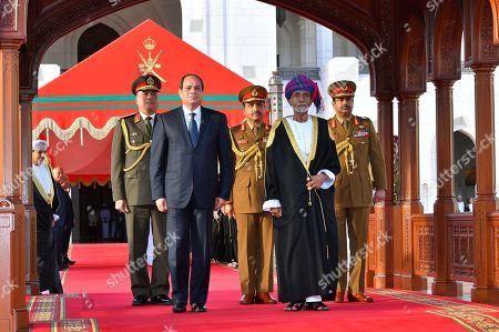 Stock Picture of Egyptian President Abdel Fattah al-Sisi and Oman's Sultan Qaboos bin Said al Said review the honor guards in Muscat