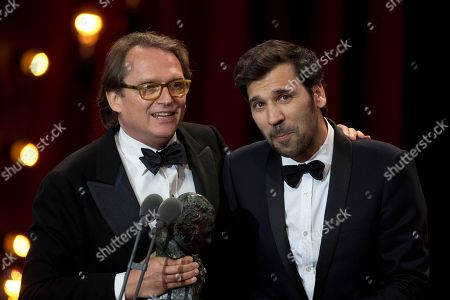 Film director Ruben Ostlund, left holds the Goya next to and actor Claes Bang after the film The Square won the Best European Film prize during the Goya Film Awards Ceremony in Madrid, Spain