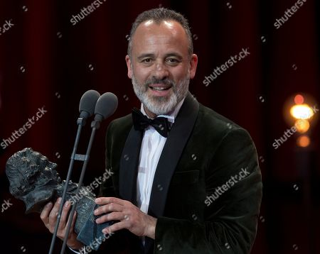 Javier Gutierrez holds his Goya award after winning Best Leading Actor Prize for the film El Autor during the Goya Film Awards Ceremony in Madrid, Spain
