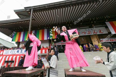 (L to R) Sumo wrestlers Kisenosato Yutaka and Hakuho Sho, take part in the Setsubun festival at Naritasan Shinshoji Temple