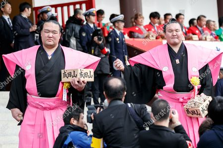 (L to R) Sumo wrestlers Kisenosato Yutaka and Hakuho Sho take part in the Setsubun festival at Naritasan Shinshoji Temple