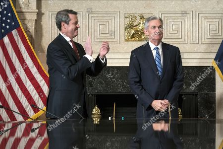 Stock Image of Jerome H. Powell (R) takes the oath of office as Chairman of the Board of Governors of the Federal Reserve System from Federal Reserve Board Member Vice Chairman for Supervision, Randal Quarles (L) in Washington, DC, USA, 05 February 2017. Powell replaces former Fed chair Janet Yellen.