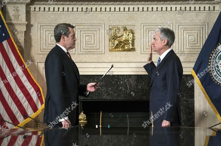 Stock Photo of Jerome H. Powell (R) takes the oath of office as Chairman of the Board of Governors of the Federal Reserve System from Federal Reserve Board Member Vice Chairman for Supervision, Randal Quarles (L) in Washington, DC, USA, 05 February 2017. Powell replaces former Fed chair Janet Yellen.