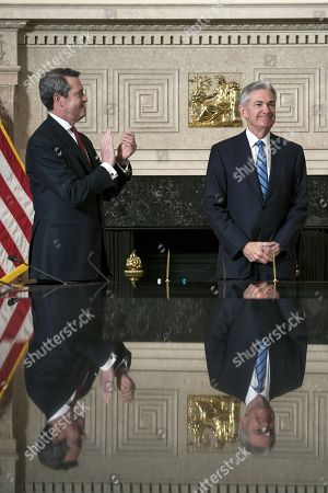 Jerome H. Powell (R) takes the oath of office as Chairman of the Board of Governors of the Federal Reserve System from Federal Reserve Board Member Vice Chairman for Supervision, Randal Quarles (L) in Washington, DC, USA, 05 February 2017. Powell replaces former Fed chair Janet Yellen.