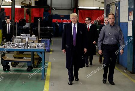 President Donald Trump participates in a tour of Sheffer Corporation with company president and CEO Jeff Norris, right, to promote his tax policy, in Cincinnati. Treasury Secretary Stephen Mnuchin and Sen. Rob Portman, R-Ohio, back right, follow