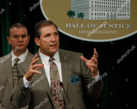 Stock Photo of Christopher Bergner, John Corina. Los Angeles County Sheriff's Department Homicide Bureau Capt. Christopher Bergner, left, looks on as Lt. John Corina, right, discusses the most recent details of the Natalie Wood death investigation at a news conference in Los Angeles, . Corina is hoping renewed interest in the 1981 death of Wood in the ocean off Southern California will produce more witnesses to shed light on what happened
