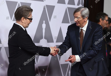 Gary Oldman, John Bailey. Gary Oldman, left, greets John Bailey as they arrive at the 90th Academy Awards Nominees Luncheon at The Beverly Hilton hotel, in Beverly Hills, Calif