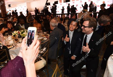 Christopher Rivera, Gary Oldman. Christopher Rivera, left, and Gary Oldman attend AARP The Magazine's 17th Annual Movies for Grownups Awards at Beverly Wilshire Hotel on in Beverly Hills, Calif