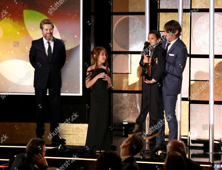 "Valeria Cotto, Christopher Rivera, Sean Baker. Valeria Cotto, from left, Christopher Rivera, and Sean Baker accept the award for best intergenerational film for ""The Florida Project"" at AARP The Magazine's 17th Annual Movies for Grownups Awards at Beverly Wilshire Hotel on in Beverly Hills, Calif"