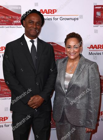 Stock Photo of Hebert Peck, Jo Ann Jenkins. Hebert Peck, left, and AARP CEO Jo Ann Jenkins attend AARP The Magazine's 17th Annual Movies for Grownups Awards at Beverly Wilshire Hotel on in Beverly Hills, Calif