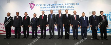 Stock Image of ASEAN defense ministers pose for a photo during a joint call on Singapore's Prime Minister Lee Hsien Loong at the Singapore Airshow ahead of the ASEAN Defense Ministers' Meeting, in Singapore. From left to right are Brunei's Haji Awang Halbi bin Haji Mohd Yusof, Cambodia's Tea Banh, Indonesia's Ryamizard Ryacudu, Laos' Chansamone Chanyalath, Malaysia's Hishammuddin Hussein, Singapore's Lee Hsien Loong, Singapore's Ng Eng Hen, Myanmar's Sein Win, Philippines' Delfin Lorenzana, Thailand's Prawit Wongsuwon, Vietnam's Nguyen Chi Vinh and ASEAN secretary-general Le Luong Minh