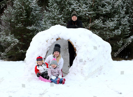 Ben Roberts and Jade McKechan with kids Archie and Elsie from Nottingham in an Igloo which has been built at Glenmore in the Highlands where temperatures are forecast to fall to -14C tonight