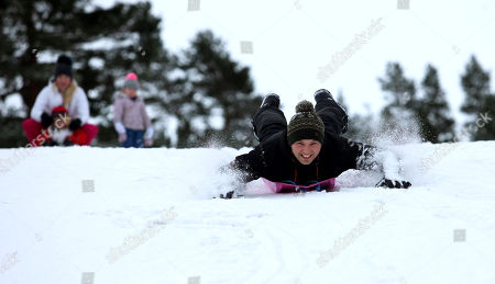 Ben Roberts from Nottingham sledging at Glenmore in the Highlands where it is forecast to be -14C tonight