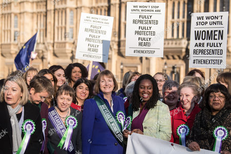Stock Photo of Yvette Cooper, Maria Eagle, Harriet Harman, Diane Abbott and other female Labour MPs and members of the Labour Party at a photocall launching a year long campaign to celebrate the centenary of women's suffrage