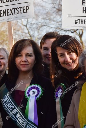 Caroline Flint, Mary Creagh, Liz Kendall. Female members of the shadow cabinet and Labour politicians wearing suffrage rosettes and banners stand outside the Houses of Parliament