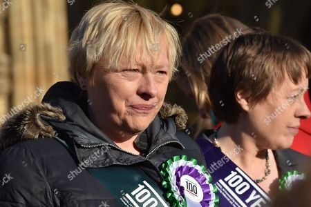 Angela Eagle, Maria Eagle. Female members of the shadow cabinet and Labour politicians wearing suffrage rosettes and banners stand outside the Houses of Parliament