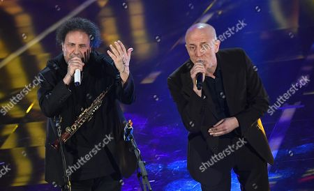 Italian singers Enzo Avitabile (L) and Peppe Servillo (R) perform on stage during the 68th Sanremo Italian Song Festival at the Ariston theatre in Sanremo, Italy, 06 February 2018.The festival will run from 06 to 10 February.
