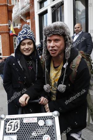 Laurie Love (R) and his girlfriend Sylvia Mann leave the Ecuadorian Embassy