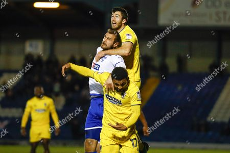 AFC Wimbledon defender Jonathan Meades (3) is pulled for fouling Bury forward James Hanson (32), on loan from Sheffield United,  during the EFL Sky Bet League 1 match between Bury and AFC Wimbledon at the JD Stadium, Bury. Picture by Simon Davies