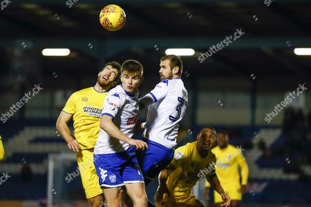 AFC Wimbledon defender Jonathan Meades (3) goes up with Bury forward George Miller (19), on loan from Middlesbrough,  during the EFL Sky Bet League 1 match between Bury and AFC Wimbledon at the JD Stadium, Bury. Picture by Simon Davies
