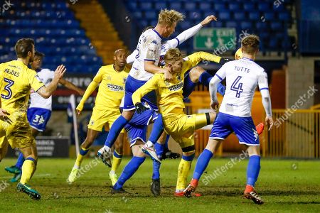 Bury defender Adam Thompson (5) wins the battle in the box with AFC Wimbledon forward Joe Pigott (39)  during the EFL Sky Bet League 1 match between Bury and AFC Wimbledon at the JD Stadium, Bury. Picture by Simon Davies