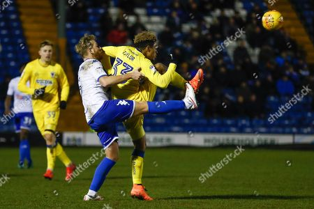 Bury defender Adam Thompson (5)battles with AFC Wimbledon forward Lyle Taylor (33)  during the EFL Sky Bet League 1 match between Bury and AFC Wimbledon at the JD Stadium, Bury. Picture by Simon Davies