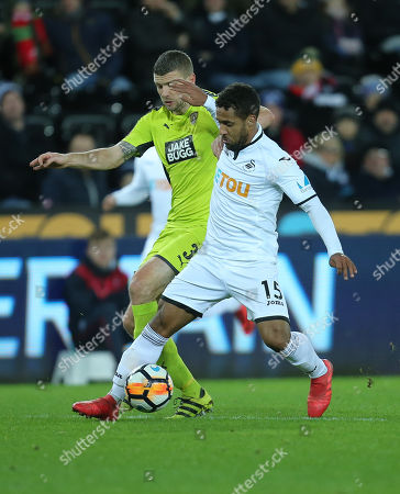 Wayne Routledge of Swansea City takes on Carl Dickinson of Notts County