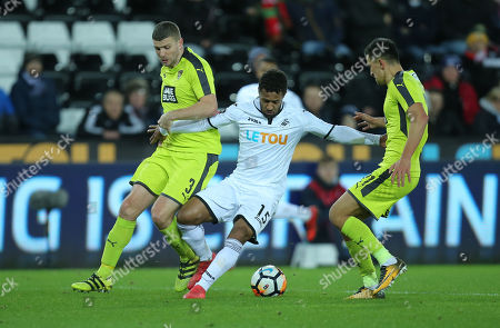 Wayne Routledge of Swansea City takes on Carl Dickinson and Noor Husin of Notts County