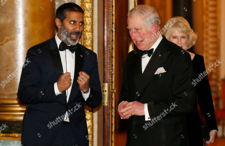 Britain's Prince Charles, speaks to broadcaster Nihal Arthanayake as he arrives for a reception and dinner in aid of the Britain Asian Trust at Buckingham Palace in London