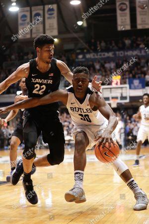 Kaiser Gates, Kelan Martin. Butler forward Kelan Martin (30) drives on Xavier forward Kaiser Gates (22) in the second half of an NCAA college basketball game in Indianapolis, . Xavier defeated Butler 98-93