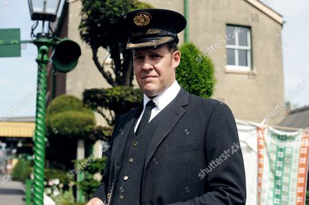 Stock Picture of Justin Edwards as Station Master Paterson