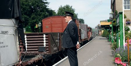 Stock Photo of Justin Edwards as Station Master Paterson
