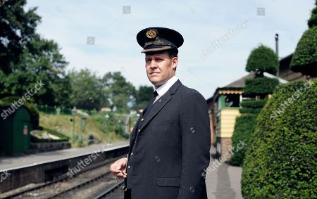 Stock Image of Justin Edwards as Station Master Paterson
