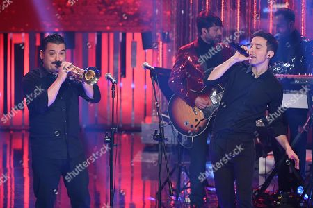 Italian singers Roy Paci (L) and Diodato (R) perform during the 'DopoFestival' tv show on occasion of the 68th Sanremo Italian Song Festival, in Sanremo, Italy, 07 February 2018. The festival will run from 06 to 10 February.