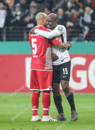 Frankfurt's Jetro Willems (R) hugs Mainz player Nigel De Jong after the German DFB Cup quarter final soccer match between Eintracht Frankfurt and FSV Mainz 05 in Frankfurt am Main, Germany, 07 February 2018. (ATTENTION: The DFB prohibits the utilisation and publication of sequential pictures on the internet and other online media during the match (including half-time). ATTENTION: BLOCKING PERIOD! The DFB permits the further utilisation and publication of the pictures for mobile services (especially MMS) and for DVB-H and DMB only after the end of the match.)