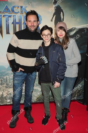 Christophe Michalak, Delphine McCarty and their son (center)