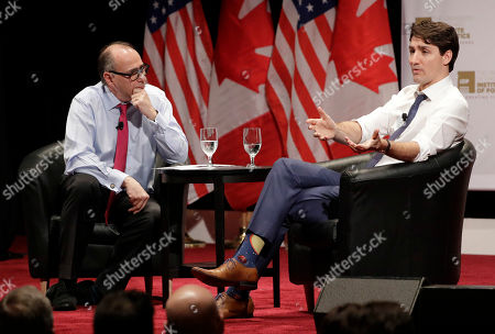 Justin Trudeau, David Axelrod. Canadian Prime Minister Justin Trudeau, right, responds to a question from founder and director, David Axelrod, at the University of Chicago Institute of Politics, in Chicago